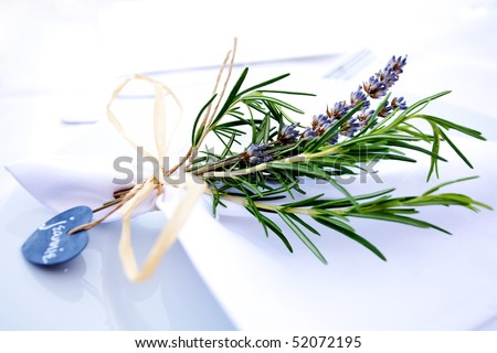 stock photo Table decor at a wedding made of rosemary and lavender tied