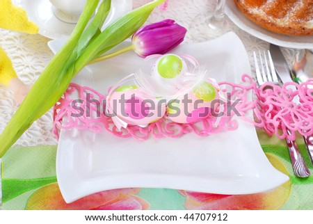 stock photo : table decorated for easter time in white and pink colors