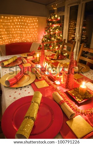 Table decorated red and gold for Christmas day dinner