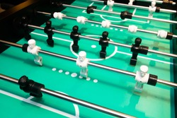 Table football game or table soccer, foosball plastic player funny game .