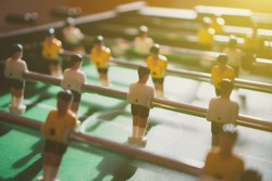 Table football game with yellow and white players.