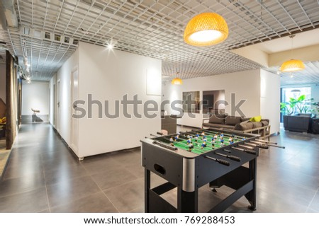 table football in modern living room in company