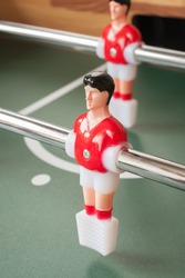 Table football players selective focus on red player