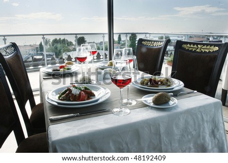 table for four people at roof restaurant