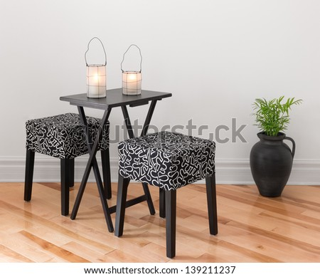 Table for two decorated with lanterns. Simple design. #139211237