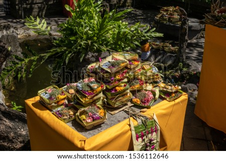 Table full of Hindu religious offerings ACat the Balinese ceremony