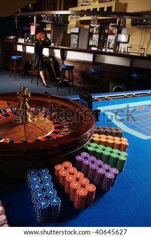 Table in a casino with a roulette and counters