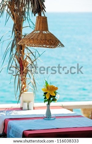 Table in a restaurant by the sea.