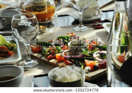 table in a restaurant served with vegetables #1202724778