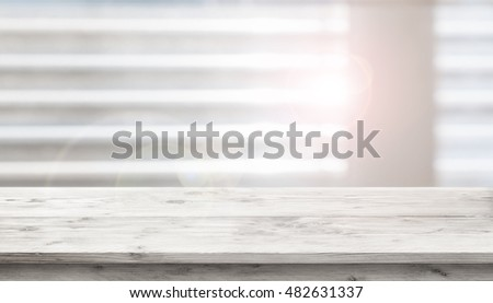 Table in front of a window with sunlight