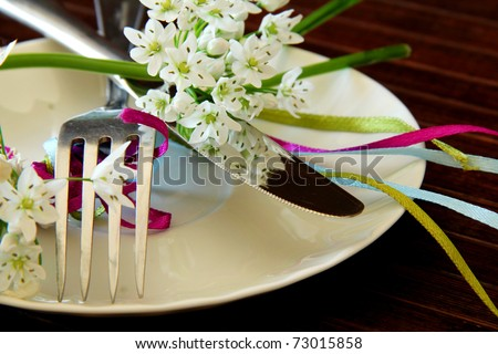 Table Laid For wedding , A Romantic Dinner or other events. Table Setting with flowers