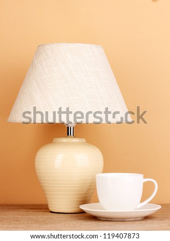 table lamp and cup on beige background