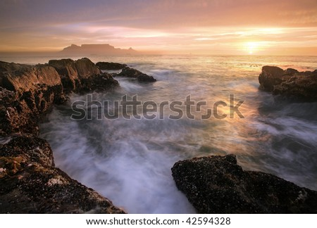 Table mountain and cape town evening - stock photo