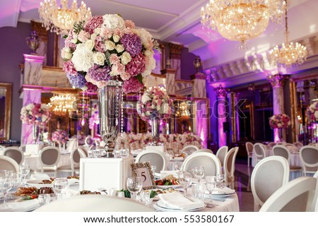 Table number 5 decorated with pink and violet hydrangeas and served with sparkling glassware Сток-фото ©
