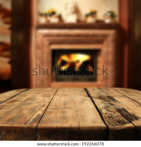 table of brown and interior with shadows and fireplace