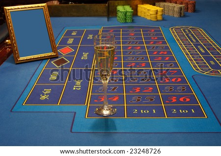 table of casino, blue, glass of wine and scope for inscription on it Photo stock ©