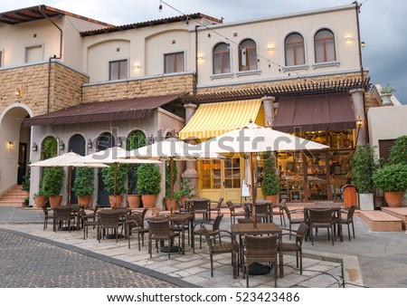 Table of food center tuscan style town in the evening,tuscana town #523423486