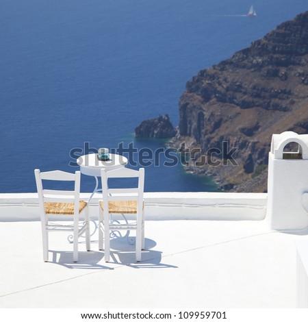 table on the sea mediterranean santorini - stock photo