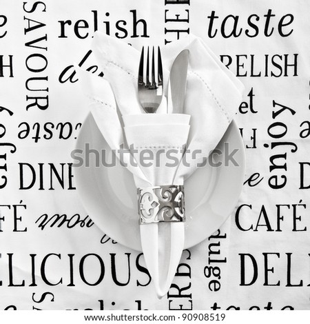 Table place setting with printed white linen