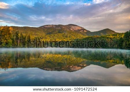 Table Rock State Park and Pinnacle Lake at sunrise near Greenville South Carolina #1091472524