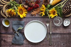 Table scape for Thanksgiving day dinner. Table decoration for festive autumn family party. Rustic style, selective focus