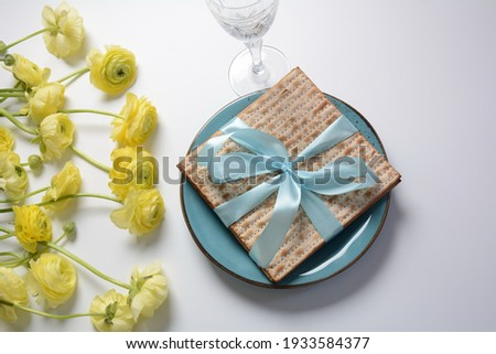 Table served for Passover (Pesach) indoors, with matzah bread as symbolic Pesach (Passover Seder) item.
