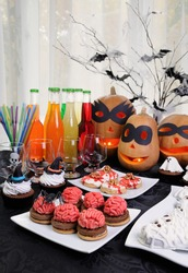 Table served with a variety of sweets and drinks on Halloween