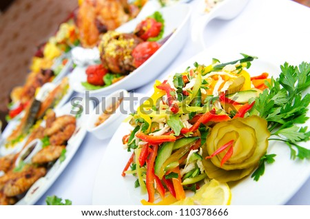 Table served with tasty meals - stock photo