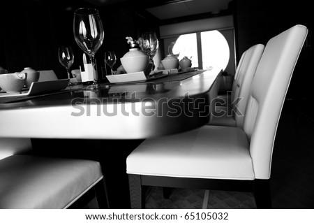 Table set for a elegant dinner , black and white.