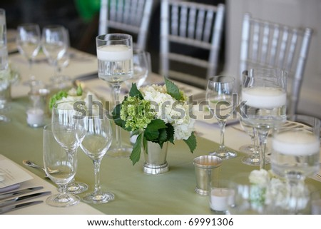Table set for an event party or wedding reception, focus on bouquet
