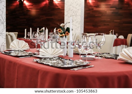 Table set for dinner in modern restaurant