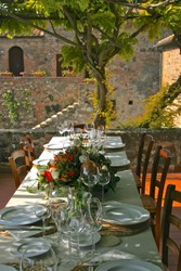 Table set for dinner in Tuscan countryside