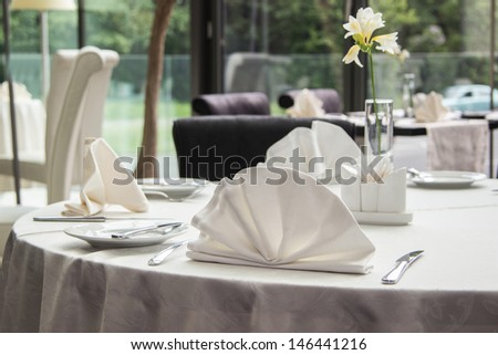 Table set for meal in modern restaurant