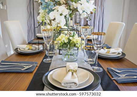 Table set on wood dinning table at home Modern dinning room