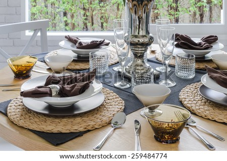 table set on wooden round table in dining room at home #259484774