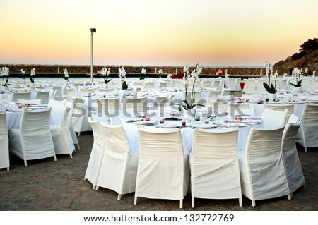 Table set up for a wedding ceremony on beach resort