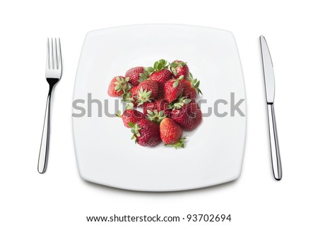 table set with strawberries on plate, isolated on white