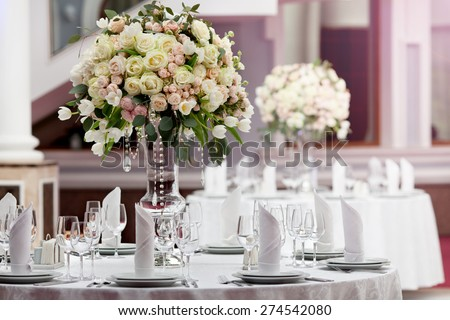 Table setting at a luxury wedding reception #274542080