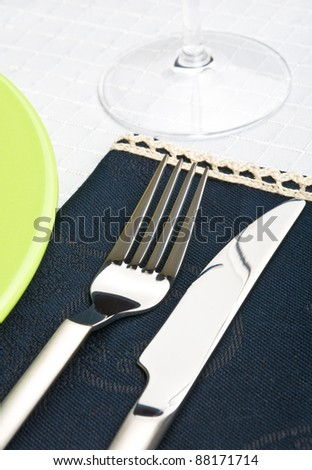 Table setting close up. See more my cutlery photos: http://www.shutterstock.com/sets/65705-cutlery.html?rid=522649