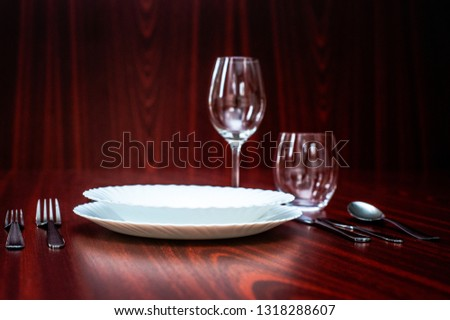 Table setting for one person on a dark wooden table