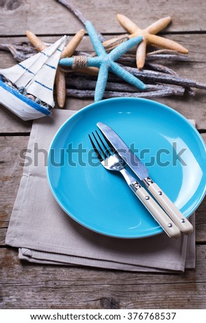 Table setting for summer. Knife and fork on blue plate and ocean theme decorations on & Popular Free Table setting for summer. Knife and fork on blue plate ...