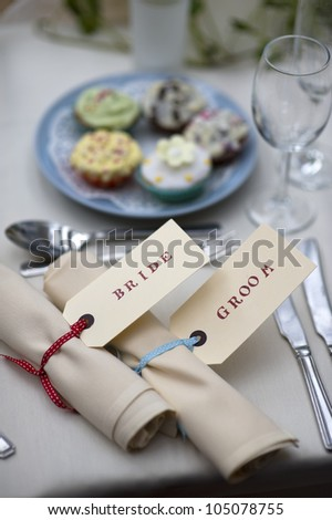table setting for the bride and groom at a wedding meal