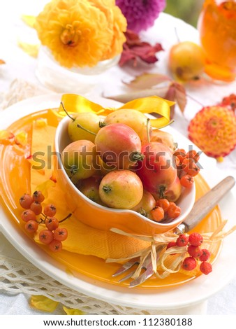 Table setting in orange and yellow tones, selective focus