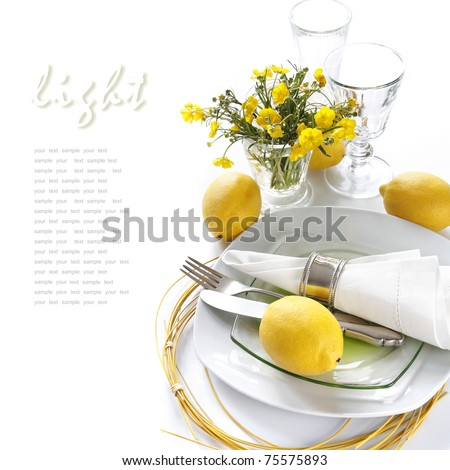 Table setting in white and yellow tones