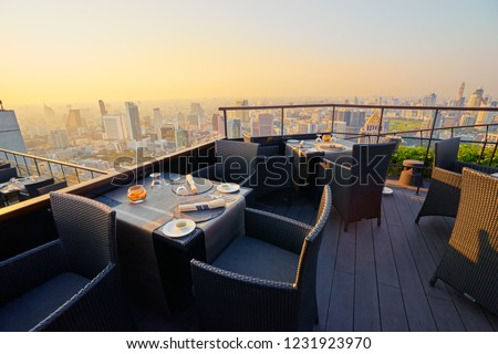 Table setting on roof top restaurant with megapolis view, Bangkok Thailand. #1231923970