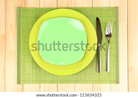 Table setting on wooden background close-up