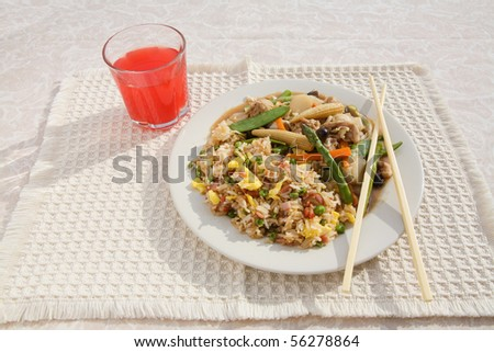 table setting with chinese stir-fry and ham fried rice with red beverage