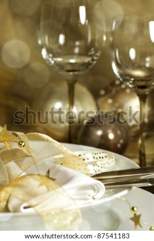 Table setting with Christmas decorations in gold