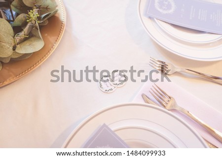 Table setting with drink cards at Summer wedding