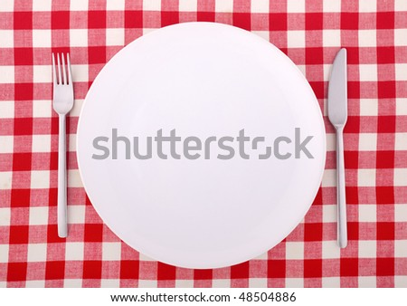 Table setting with fork, knife and an empty plate